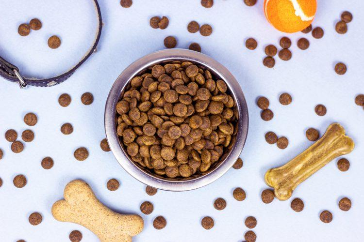 Top View Of Brown Biscuit Bones And Crunchy Organic Kibble